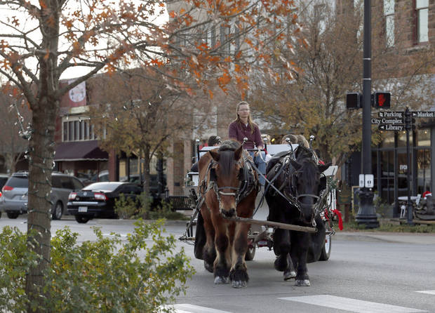 Wendy Meyer drives a team of horses in downtown Edmond on Thursday.  Photos by Sarah Phipps, The Oklahoman