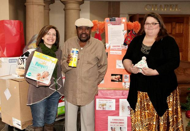 From left, Erin Barnhart with Center for Children and Families, Johnnie Mitchell, and Shelly McKee with the Norman Veterans Center show some donations.  PHOTO PROVIDED BY CENTER FOR CHILDREN AND FAMILIES
