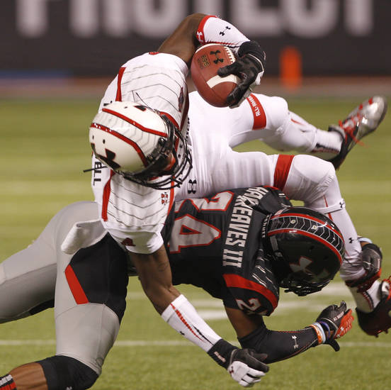 Wharton High School's Vernon Hargreaves III (24) stops Crete Monee High School's Laquon Treadwell (4) during the second quarter of the Under Armour All-America High School Football Game at Tropicana Friday, Jan. 4, 2013.  (AP Photo/Tampa Bay Times, Lara Cerri) ORG XMIT: FLPET202