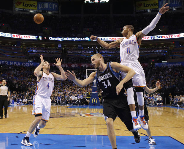 Oklahoma City's Russell Westbrook (0) passes the ball over Minnesota's Greg Stiemsma (34) during an NBA basketball game between the Oklahoma City Thunder and the Minnesota Timberwolves at Chesapeake Energy Arena in Oklahoma City, Wednesday, Jan. 9, 2013.  Oklahoma City won 106-84. Photo by Bryan Terry, The Oklahoman