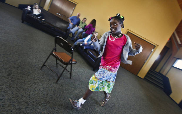 Adopted Haitian child Ochelle Mortensen enjoys running around the room after a press conference held by the families that adopted children from Haiti at the Cherokee Hill Christian Church on Friday, Jan. 22,, 2010, in Oklahoma City, Okla.   Photo by Chris Landsberger, The Oklahoman