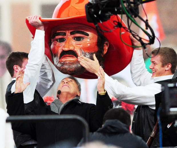 ESPN College Gameday host Lee Corso puts on the Pistol Pete head to pick Oklahoma State to defeat Baylor on November 23, 2013 during the show's broadcast Saturday morning, November 23, 2013 from Oklahoma State's library lawn. Photo by KT King/For the Oklahoman