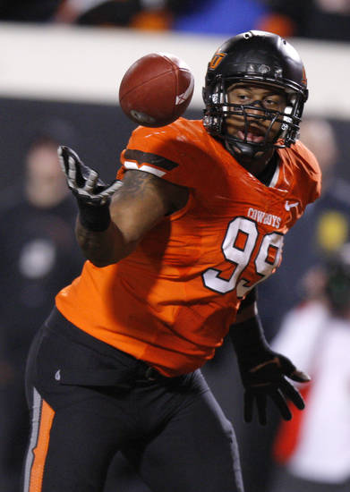 Oklahoma State&#039;s Richetti Jones (99) recovers a fumble during the Bedlam college football game between the Oklahoma State University Cowboys (OSU) and the University of Oklahoma Sooners (OU) at Boone Pickens Stadium in Stillwater, Okla., Saturday, Dec. 3, 2011. Photo by Bryan Terry, The Oklahoman