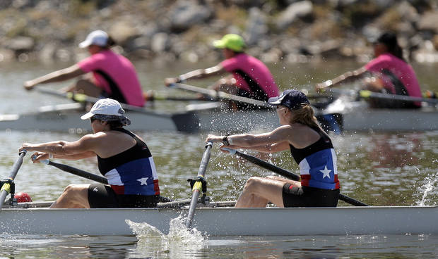 Members of Texas Rowing compete in the Womens' Open 3 4x during the USRowing Masters National Championships on the Oklahoma River, Sunday, Aug. 14, 2011. Photo by Sarah Phipps, The Oklahoman