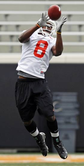 OSU's Daytawion Lowe (8) catches the ball as part of a drill during Oklahoma State spring football practice at Boone Pickens Stadium in Stillwater, Okla., Monday, March 7, 2011. Photo by Nate Billings, The Oklahoman