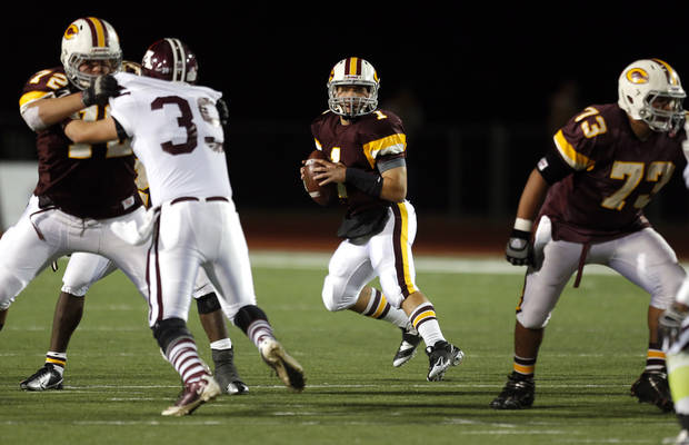 Clinton's Garrison Mendoza looks to throw a pass during the high school playoff game between Ada and Clinton at Putnam City High School in Oklahoma City, Friday, Nov. 23, 2012. Photo by Sarah Phipps, The Oklahoman