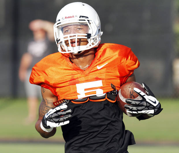 OKLAHOMA STATE UNIVERSITY / OSU / COLLEGE FOOTBALL: Oklahoma State wide receiver Josh Stewart runs upfield after catching a pass during the first full pad practice of the fall on August 6, 2013. Photo by KT King/ for The Oklahoman
