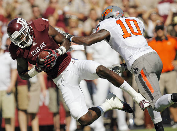 Jeff Fuller (8) of Texas A&M makes a touchdown catch in front of OSU's Markelle Martin (10) in the second quarter of their game Saturday. Photo by Nate Billings, The Oklahoman