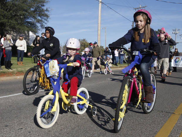 Bicyclers ride by during the University of Central Oklahoma's homecoming parade in Edmond, OK, Saturday, November 3, 2012,  By Paul Hellstern, The Oklahoman