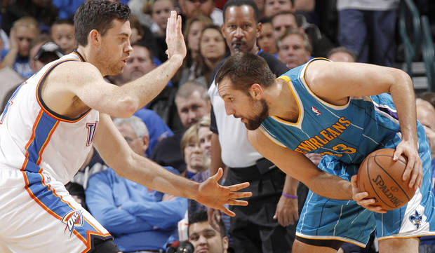 Oklahoma City Thunder&#039;s Nick Collison (4) defends on New Orleans Hornets&#039; Ryan Anderson (33) during the NBA basketball game between the Oklahoma CIty Thunder and the New Orleans Hornets at the Chesapeake Energy Arena on Wednesday, Dec. 12, 2012, in Oklahoma City, Okla.   Photo by Chris Landsberger, The Oklahoman ORG XMIT: KOD