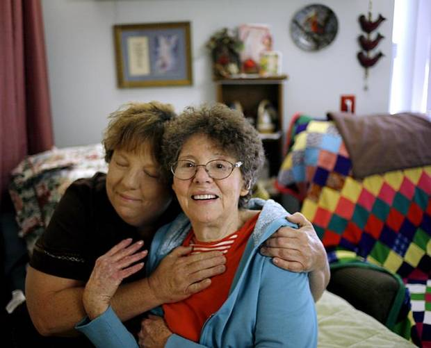 HELEN DAVIS / MULTIGENERATIONAL INCOME: Tammy Moore and her mother Helen Lucille Davis pose in Helen's room at The Lakes Assisted Living Center  in Oklahoma City on Wednesday, May 27, 2009. Photo by John Clanton, The Oklahoman ORG XMIT: KOD