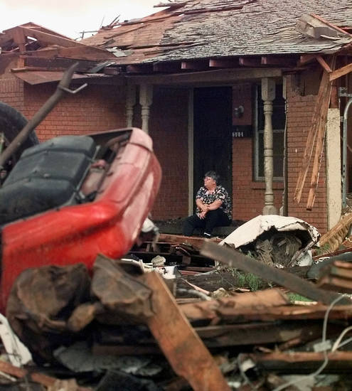 MAY 3, 1999 TORNADO: Tornado damage: An unidentified woman sits on the porch of a Midwest City home on SE 9th damaged in Monday night's tornado.