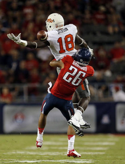 Arizona's Jourdon Grandon (26) breaks up a pass intended to Oklahoma State's Blake Jackson (18) during the college football game between the University  of Arizona and Oklahoma State University at Arizona Stadium in Tucson, Ariz.,  Saturday, Sept. 8, 2012. Photo by Sarah Phipps, The Oklahoman