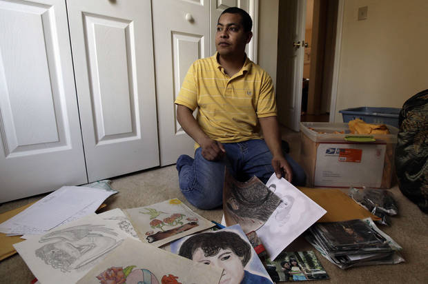 Pedro Guzman looks through items he made and collected while incarcerated. U.S. Immigration and Customs Enforcement detained the Guatemalan native in 2009, and he spent 19 months in private prisons run by CCA in Gainesville and Lumpkin, Ga. Guzman was released and granted legal permanent residency in May, when ICE's Board of Immigration Appeals overturned his deportation order. AP FILE PHOTO <strong>Gerry Broome</strong>