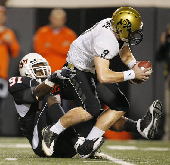 OSU's Ugo Chinasa sacks Colorado quarterback Tyler Hansen in the first quarter. Photo by Nate Billings, The Oklahoman