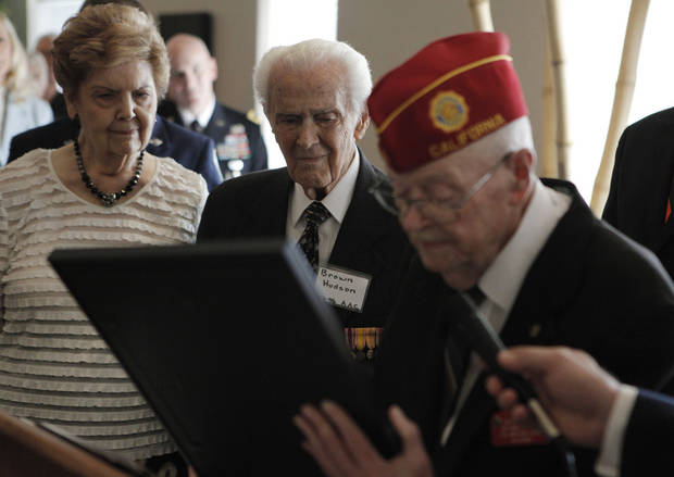 Dr. Calvin C. Turpin, former chaplain of The American Legion, gives recognition to Brown R. Hudson, who stands next to his wife, Jeanne, during an American Legion veterans ceremony at the Edmond Mansions retirement village. Hudson drew up the maps for the bombing of Hiroshima and Nagasaki, Japan, in World War II.