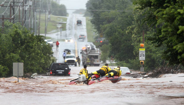 Oklahoma City firefighters navigate their  rescue boat near Hefner Road and Sooner where motorists were stranded in high water in Oklahoma City, Oklahoma June 14 , 2010. Photo by Steve Gooch, The Oklahoman