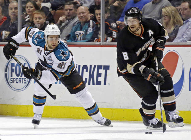 Anaheim Ducks right winger Teemu Selanne (8), of Finland, skates against San Jose Sharks left winger T.J. Haliardi (21) in the second period of an NHL hockey game in Anaheim, Calif., Monday, March 25, 2013. (AP Photo/Reed Saxon)