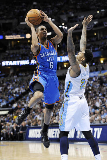 Oklahoma City Thunder guard Eric Maynor (6) shoots against Denver Nuggets forward Wilson Chandler (21) during the first half in game 4 of a first-round NBA basketball playoff series Monday, April 25, 2011, in Denver. (AP Photo/Jack Dempsey)