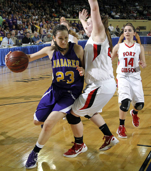 FORT GIBSON / CLASS 4A GIRLS HIGH SCHOOL BASKETBALL / STATE TOURNAMENT: Anadarko's Lakota Beatty (23) drives past Ft. Gibson's Brooke Palmer (24) during the 4A girl State Basketball Championship game between Ft. Gibson High School and Anadarko High School at State Fair Arena on Saturday, March 10, 2012 in Oklahoma City, Okla.  Photo by Chris Landsberger, The Oklahoman