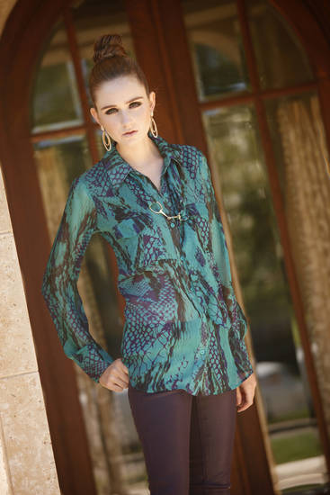 Halo Bob reptile print silk blouse with Habitual waxed jeans available at Liberte.  Makeup by L.J. Hill. Hair by Dianne Truong, Trichology Salon. Photo by Doug Hoke, The Oklahoman   <strong>DOUG HOKE</strong>