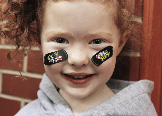 Prekindergarten student Kyley Mundell, 4, wears NFL Play 60 stickers during a National School Breakfast Week event at Pleasant Hill Elementary.
