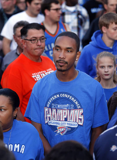 Deon Anderson, Oklahoma City, wear his division title shirt as the Oklahoma City Thunder play the Atlanta Hawks in NBA basketball at the Chesapeake Energy Arena in Oklahoma City, on Sunday, Nov. 4, 2012.  Photo by Steve Sisney, The Oklahoman