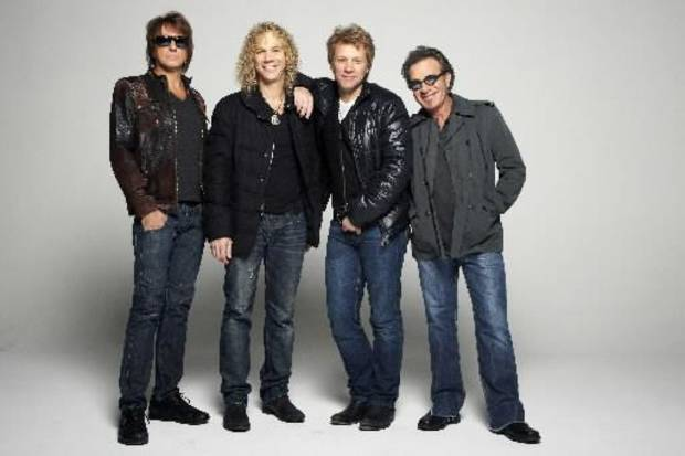 In this Nov. 29, 2012, photo, rock band Bon Jovi, from left, Richie Sambora, David Bryan, Jon Bon Jovi and Tico Torres pose for a portrait in the Brooklyn Borough of New York.