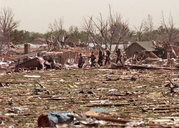 MAY 3, 1999 TORNADO: Members of the National Guard survey the tornado damage on south 44th just east west of Sooner on Del City.