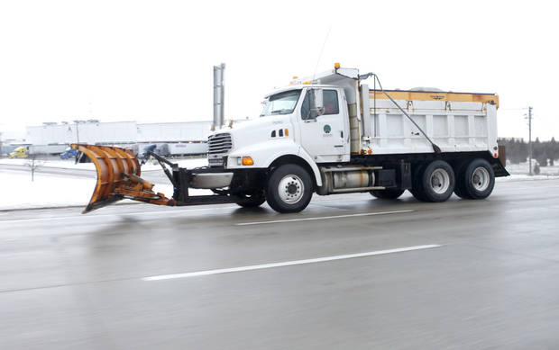 An Oklahoma Turnpike Authority snowplow prepares to make another pass on the Kilpatrick Turnpike after about an inch of snow fell overnight in Oklahoma City, OK, Monday, Feb. 13, 2012. By Paul Hellstern, The Oklahoman