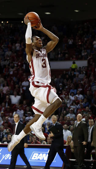 Oklahoma's Buddy Hield goes up for a dunk after a steal at the close of the second half as the University of Oklahoma Sooners (OU) defeat the Kansas Jayhawks (KU) 72-66 in NCAA, men's college basketball at Lloyd Noble Center on Saturday, Feb. 9, 2013 in Norman, Okla. Hield made the dunk, but the points were too late to count. Photo by Steve Sisney, The Oklahoman