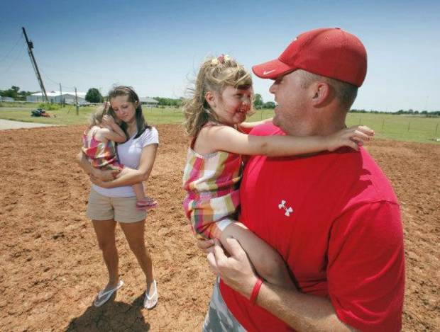 Brad Beller, wife Kami, and their daughters Kelby, 3, and Briley, 1, stand of the site of their former home on Thursday, June 16, 2011, in Goldsby, Okla. Photo by Steve Sisney, The Oklahoman <strong>STEVE SISNEY</strong>