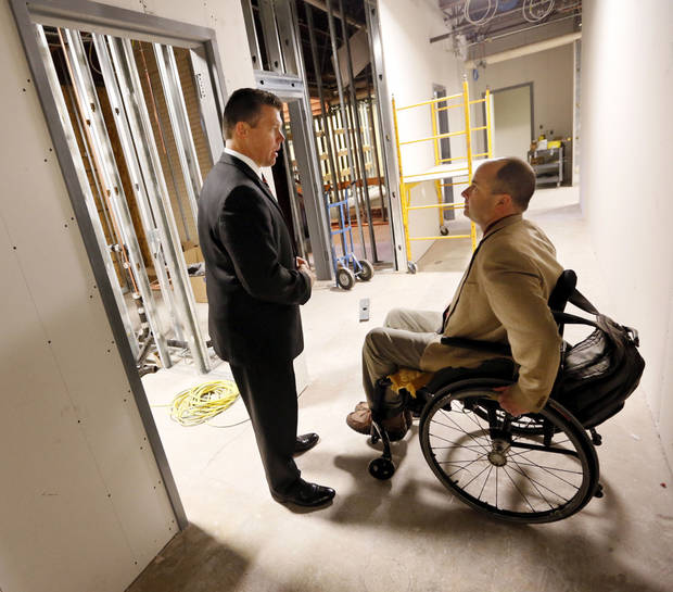 Gary Lynch, director of development for the Oklahoma Blood Institute, left, talks with State Rep. John Enns at the future  location of OBI's umbilical cord blood bank, under construction at 1001 N Lincoln.  Photo by Nate Billings, The Oklahoman <strong>NATE BILLINGS - NATE BILLINGS</strong>