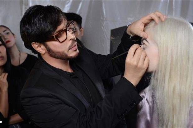 This Sept. 10, 2012 photo shows make-up artist Francois Nars, preparing a model for the Marc Jacobs Spring 2013 collection during Fashion Week in New York. Nars&#039; company has taken on Andy Warhol&#039;s silvery Factory, silkscreened superstars and avant-garde films in a limited-edition cosmetic collection, exclusive to Sephora stores until Nov. 1. (AP Photo/Nars Cosmetics)