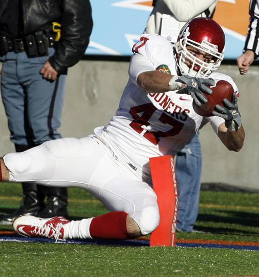 Trent Ratterree tries to stretch a catch into a touchdown during the second half of the Brut Sun Bowl college football game between the University of Oklahoma Sooners (OU) and the Stanford University Cardinal on Thursday, Dec. 31, 2009, in El Paso, Tex.   Photo by Steve Sisney, The Oklahoman
