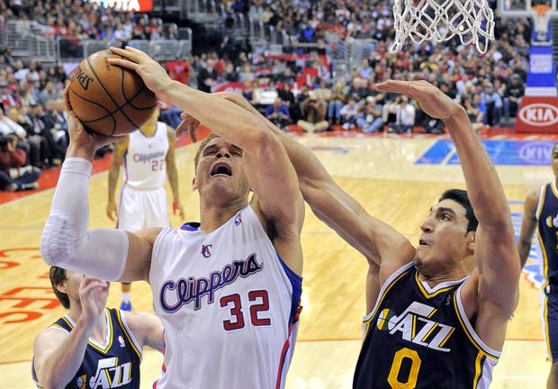Los Angeles Clippers forward Blake Griffin, left, goes up for a shot as Utah Jazz center Enes Kanter, of Turkey, defends during the first half of an NBA basketball game, Sunday, Dec. 30, 2012, in Los Angeles. (AP Photo/Mark J. Terrill)