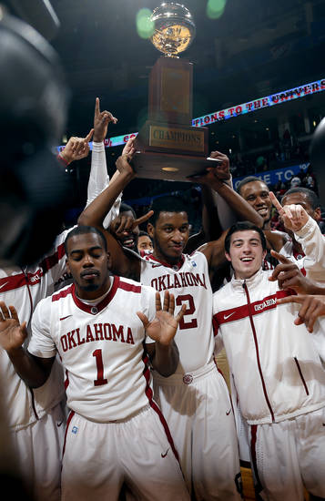 OU celebrates following the All College Classic between the University of Oklahoma and Texas A&M at the  Chesapeake Energy in  Oklahoma City, Saturday,Dec. 15, 2012. Photo by Sarah Phipps, The Oklahoman