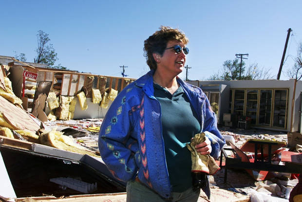 Tornado victims, damage: Jackie Pfeiffer, owner of Jackie's Farmers Store says she will rebuild the store whose ruins lay behind her.