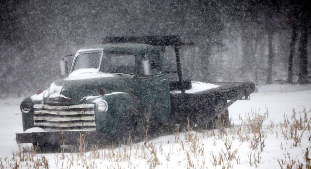 Snow covers an old truck in Logan County, Oklahoma December 24, 2009. Photo by Steve Gooch, The Oklahoman