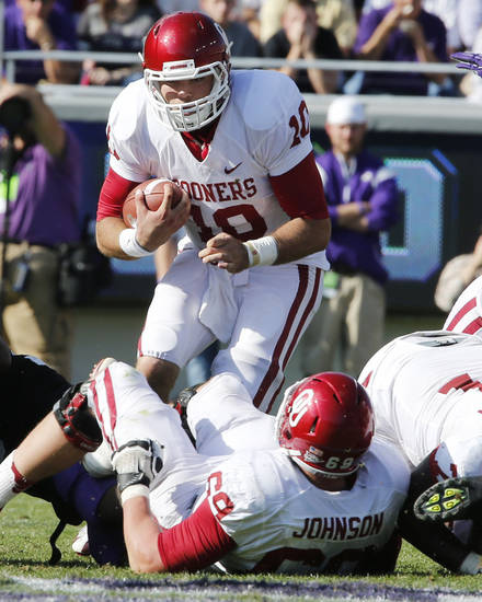 Oklahoma&#039;s Blake Bell (10) gains short yardage for a first and ten during the second half of the college football game where the University of Oklahoma Sooners (OU) defeated the Texas Christian University Horned Frogs (TCU) 24-17 at Amon G. Carter Stadium in Fort Worth, Texas, on Saturday, Dec. 1, 2012. Photo by Steve Sisney, The Oklahoman