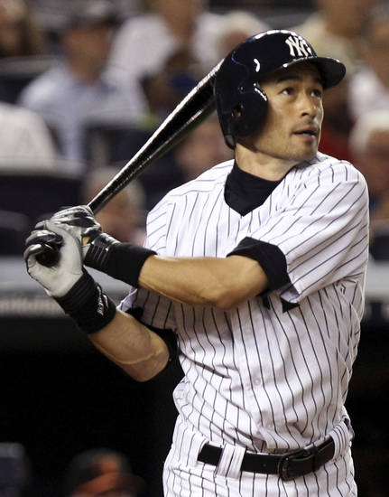 FILE In this July 30, 2012, file photo, New York Yankees' Ichiro Suzuki hits a solo home run during the seventh inning of a baseball game against the Baltimore Orioles at Yankee Stadium in New York. Suzuki and the Yankees are closing in on a contract that would guarantee the outfielder between $12 million and $13 million. A person familiar with the negotiations, speaking on condition of anonymity because talks were ongoing, said Thursday, Dec. 13, 2012, the agreement likely would be for a two-year deal. (AP Photo/Seth Wenig, File)