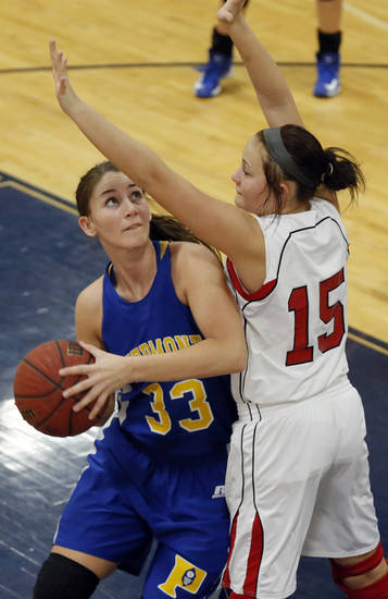 Piedmont's Sarah Parker (33) looks to shoot the ball past McLoud's Brook Johnson (15) during a basketball tournament at the Kingfisher High School gym on Thursday, Jan. 24, 2013, in Kingfisher, Okla.  Photo by Chris Landsberger, The Oklahoman