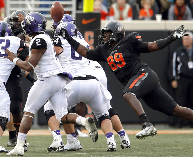 Oklahoma State's Nigel Nicholas (89) forces TCU's Trevone Boykin (2) to turn the ball over during a college football game between Oklahoma State University (OSU) and Texas Christian University (TCU) at Boone Pickens Stadium in Stillwater, Okla., Saturday, Oct. 27, 2012. Photo by Sarah Phipps, The Oklahoman