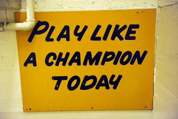 "The hallway between the locker room and the field at Notre Dame stadium features a sign ""Play like a Champion Today"" displayed Monday Nov. 21, 2011. Notre Dame football players on their way to the field for a game tap the sign. (AP Photo/Joe Raymond)"