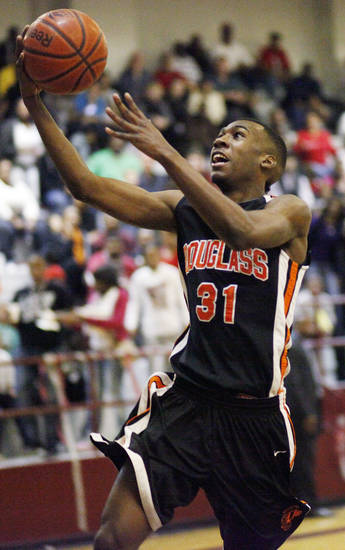 Dydrell Post (31) of Douglass takes a shot during a boys high school basketball game between Douglass and Northeast at Northeast Academy in Oklahoma City, Friday, Feb. 10, 2012. Photo by Nate Billings, The Oklahoman