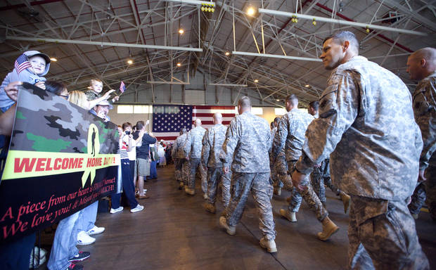 Soldiers march into a plane hanger during a homecoming ceremony for members of the Oklahoma National Guard's 45th Infantry Brigade Combat Team returning from Afghanistan and Kuwait at the Will Rogers Air National Guard Base in Oklahoma City, Thursday, April 5, 2012. Photo by Sarah Phipps, The Oklahoman