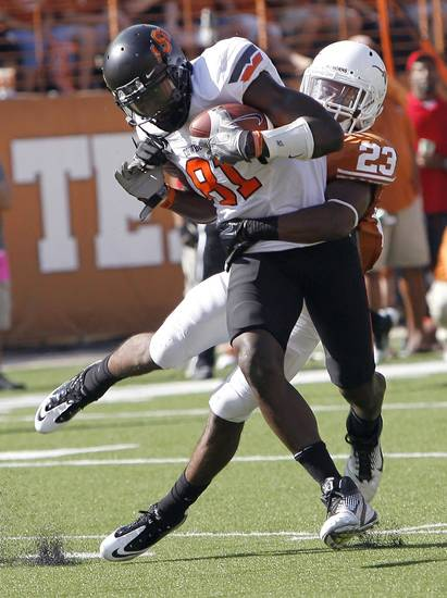 Oklahoma State's Justin Blackmon (81) gets free from Texas' Carrington Byndom (23) during first half of a college football game between the Oklahoma State University Cowboys (OSU) and the University of Texas Longhorns (UT) at Darrell K Royal-Texas Memorial Stadium in Austin, Texas, Saturday, Oct. 15, 2011. Photo by Sarah Phipps, The Oklahoman