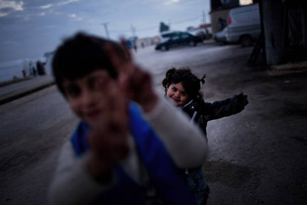 Syrian children play at a refugee camp near the Turkish border, in Azaz, Syria, Sunday, Dec. 9, 2012. (AP Photo/Manu Brabo)