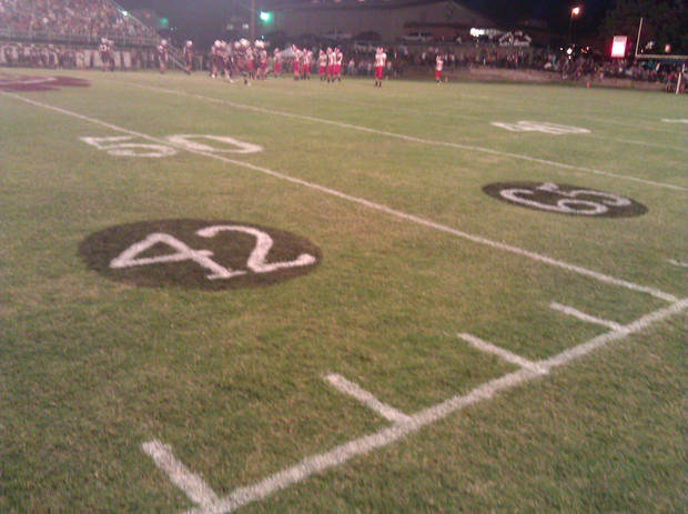 Late Stigler players Gordon Parsons' No. 42 and Cory Casinger's No. 65 were painted on Eufaula's field for the Stigler-Eufaula game on Sept. 28, 2012. PHOTO BY RYAN ABER, THE OKLAHOMAN
