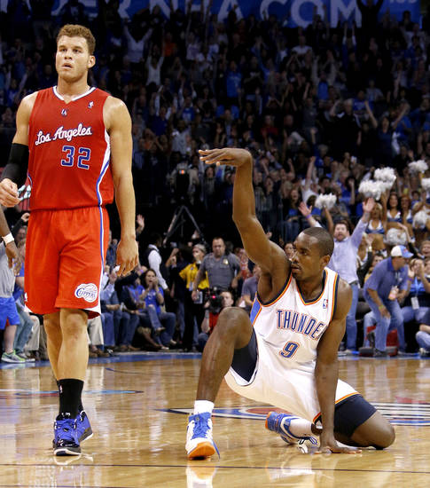 Oklahoma City's Serge Ibaka (9) reacts beside the Clippers Blake Griffin (32) after making a basket as time expires in the second quarter during an NBA basketball game between the Oklahoma City Thunder and the Los Angeles Clippers at Chesapeake Energy Arena in Oklahoma City, Wednesday, Nov. 21, 2012. Photo by Bryan Terry, The Oklahoman